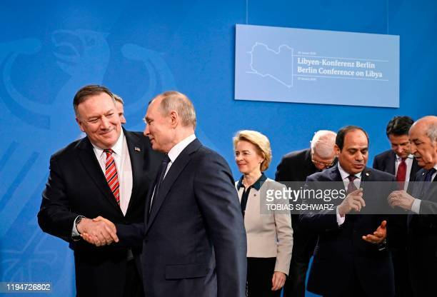 Secretary of State Mike Pompeo and Russian President Vladimir Putin shake hands, followed by President of the European Commission Ursula von der...