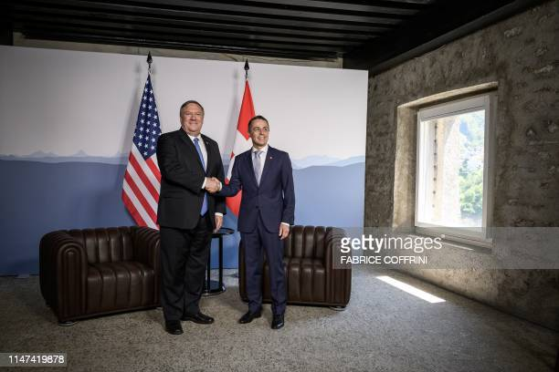 US Secretary of State Mike Pompeo and Swiss counterpart Ignazio Cassis shake hands at the Castelgrande during a bilateral meeting on June 2 2019 in...