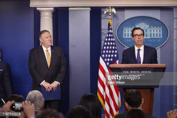 S Secretary of State Mike Pompeo and Treasury Secretary Steven Mnuchin brief reporters in the James Brady briefing room at the White House on...