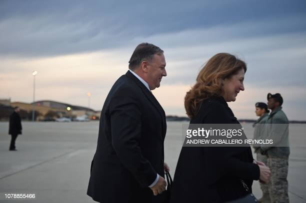US Secretary of State Mike Pompeo and wife Susan Pompeo walk to the plane prior to departing from Joint Base Andrews on January 7 2019 Pompeo will...