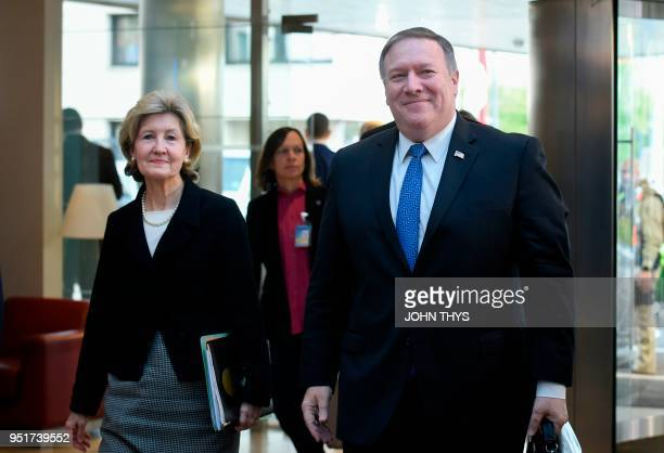 US Secretary of State Mike Pompeo arrives with US ambassador of Nato Kay Bailey Hutchison for a Foreign ministers meeting at the Nato headquarters in...