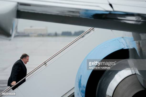 US Secretary of State Mike Pompeo boards his plane after a stopover in Japan at Yokota Air Force Base in Fussa on July 6 to travel to North Korea's...
