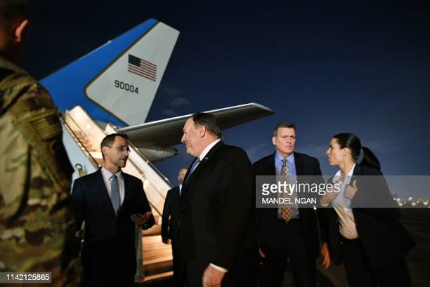 US Secretary of State Mike Pompeo chats with Charge D'affaires at the US Embassy in Baghdad Joey Hood upon arrival in Baghdad for meetings on May 7...