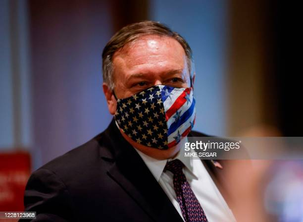 Secretary of State Mike Pompeo departs a meeting with members of the UN Security Council about Iran's alleged non-compliance with a nuclear deal at...