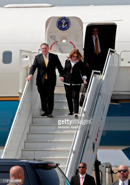 US Secretary of State Mike Pompeo escorted by his wife Susan disembarks from the plane upon landing in the Lebanese capital Beirut on March 22 on the...