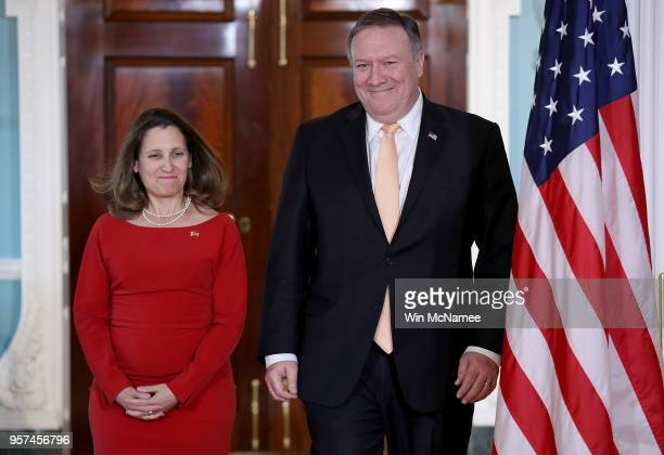 S Secretary of State Mike Pompeo escorts Canadian Foreign Minister Chrystia Freeland to a brief statement prior to a scheduled meeting at the US...