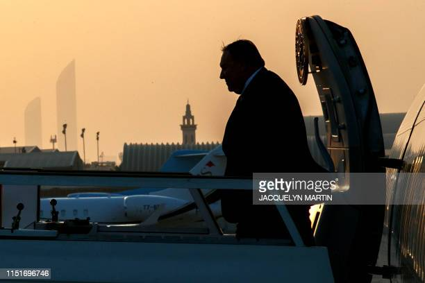 Secretary of State Mike Pompeo exits the plane at sunset as he arrives in Abu Dhabi on June 24 for meetings on Iran. - The United States, Britain,...