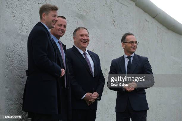 S Secretary of State Mike Pompeo German Foreign Minister Heiko Maas and US Ambassador to Germany Richard Grenell stand at a stillstanding portion of...