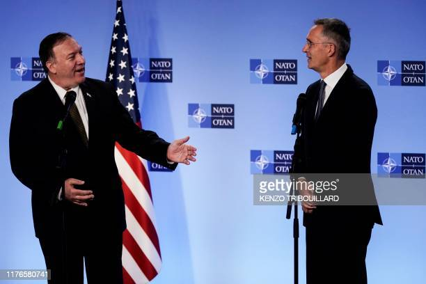 Secretary of State Mike Pompeo gestures as he delivers a speech during a joint press conference with NATO Secretary General Jens Stoltenberg...
