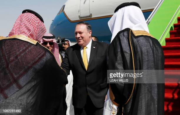 US Secretary of State Mike Pompeo greets Saudi officials upon his arrival in Riyadh on October 16 2018 Pompeo arrived in the Saudi capital for talks...