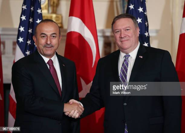 Secretary of State Mike Pompeo greets Turkish Foreign Minister Mevlut Cavusoglu before a meeting at the Department of State on June 4 2018 in...