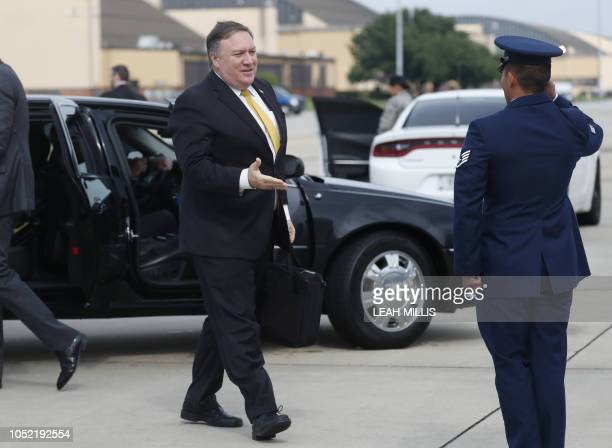 US Secretary of State Mike Pompeo heads to his plane to depart for meetings with King Salman on what happened to missing journalist Jamal Khashoggi...