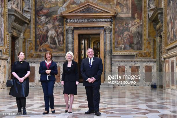 US Secretary of State Mike Pompeo his wife Susan and US Ambassador to the Holy See Callista Gingrich listen to a curator as they visit the Sala Regia...