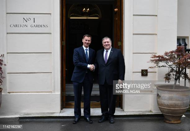US Secretary of State Mike Pompeo is greeted by Britain's Foreign Secretary Jeremy Hunt ahead of their lunch at Carlton Gardens in central London on...