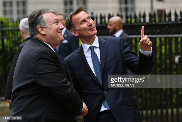 US Secretary of State Mike Pompeo is greeted by Britain's Foreign Secretary Jeremy Hunt ahead of their working lunch at Carlton Gardens in central...