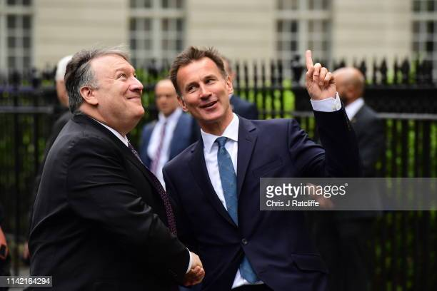 Secretary of State Mike Pompeo is greeted by Foreign Secretary Jeremy Hunt at 1 Carlton Gardens the official residence of the Foreign Secretary on...