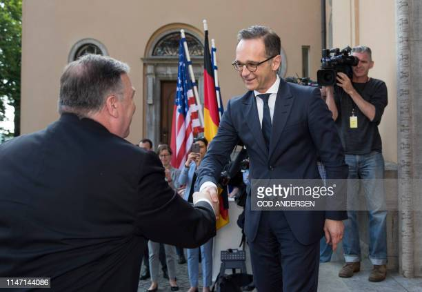 US Secretary of State Mike Pompeo is greeted by German Foreign Minister Heiko Maas prior to talks at Villa Borsig in north Berlin on May 31 2019 The...