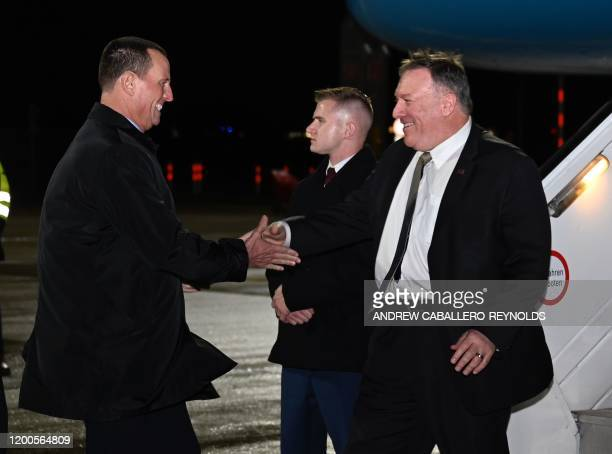 US Secretary of State Mike Pompeo is greeted by US ambassador to Germany Richard Grenell as he arrives at Munich International Airport in Germany on...