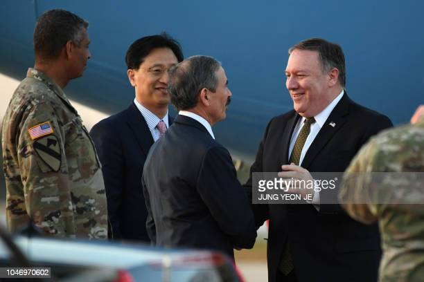 US Secretary of State Mike Pompeo is greeted by US ambassador to South Korea Harry Harris upon his arrival at Osan Air Base in Pyeongtaek on October...