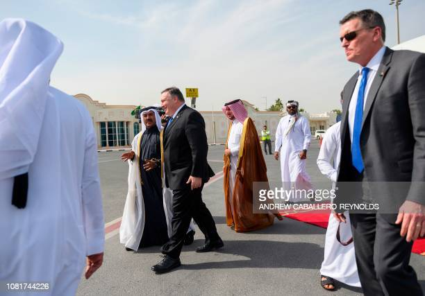 US Secretary of State Mike Pompeo is met by Qatari Secretary General of the Foreign Ministry Dr Ahmed bin Hassan Al Hammadiupon his arrival at the...