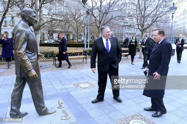 US Secretary of State Mike Pompeo is pictured next to the statue of the former US President Ronald Reagan at the Liberty square in Budapest on...