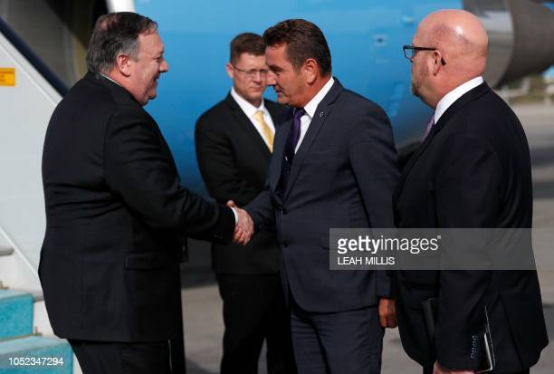 US Secretary of State Mike Pompeo is welcomed by Deputy Governor of Ankara Murat Soylu as he arrives in Ankara Turkey October 17 2018 US Secretary of...