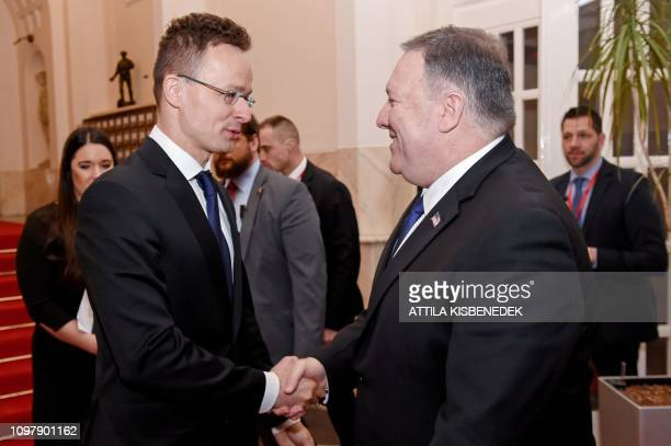 US Secretary of State Mike Pompeo is welcomed by Hungary's Minister of Foreign Affairs and Trade Peter Szijjarto in the ministry building of Budapest...