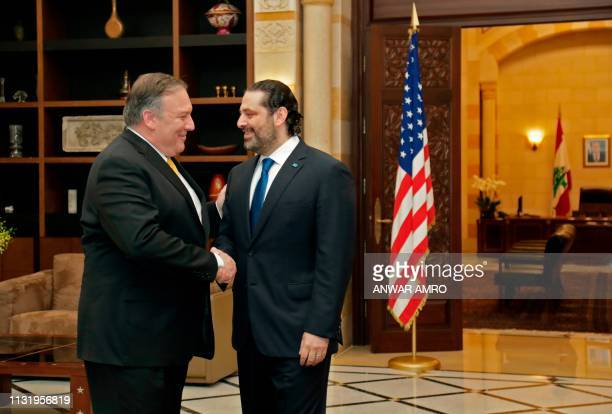 US Secretary of State Mike Pompeo is welcomed by Lebanon's Prime Minister Saad Hariri upon his arrival to the capital Beirut on March 22 2019...