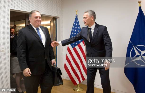 US Secretary of State Mike Pompeo is welcomed by NATO Secretary General Jens Stoltenberg prior to a meeting at NATO headquarters in Brussels on April...