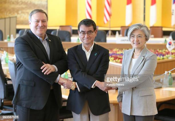 US Secretary of State Mike Pompeo Japanese Foreign Minister Taro Kono and South Korean Foreign Minister Kang Kyung Wha pose for photos ahead of their...