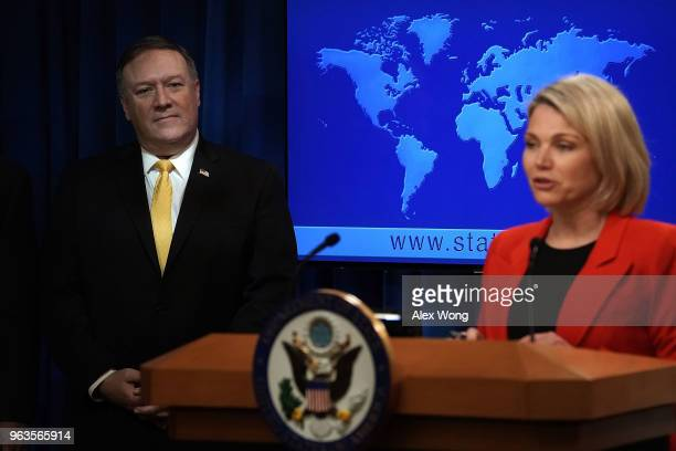 S Secretary of State Mike Pompeo listens as State Department spokesperson Heather Nauert speaks during a press event at the State Department May 29...