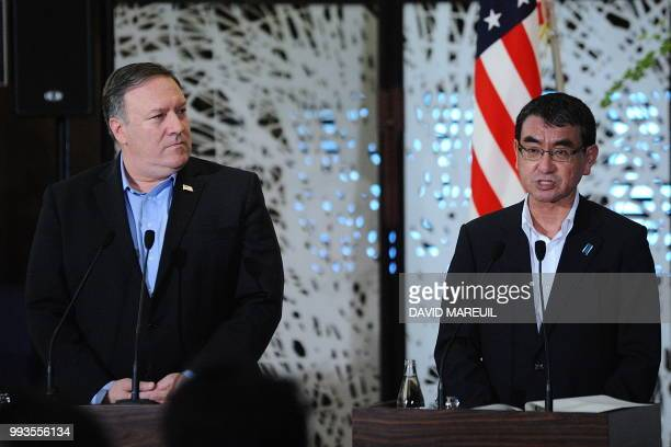 US Secretary of State Mike Pompeo listens to Japan's Foreign Minister Taro Kono during a press conference with South Korea's Foreign Minister Kang...