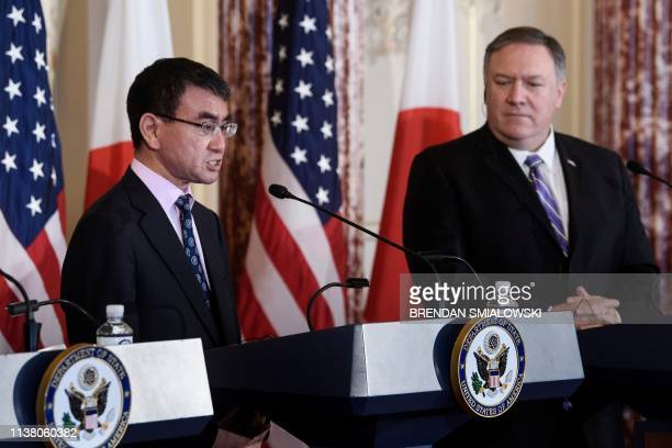 US Secretary of State Mike Pompeo listens while Japan's Foreign Minister Taro Kono speaks during a press conference after 22 meeting at the US...