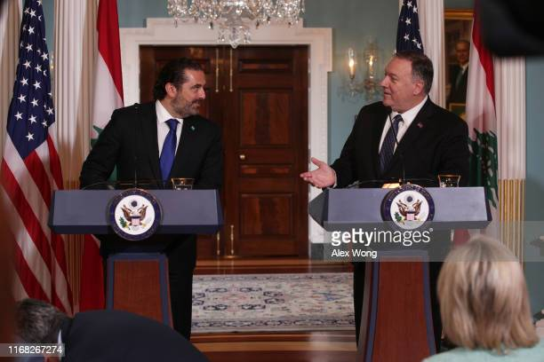 S Secretary of State Mike Pompeo makes remarks to members of the media as Lebanese Prime Minister Saad Hariri listens at the State Department August...
