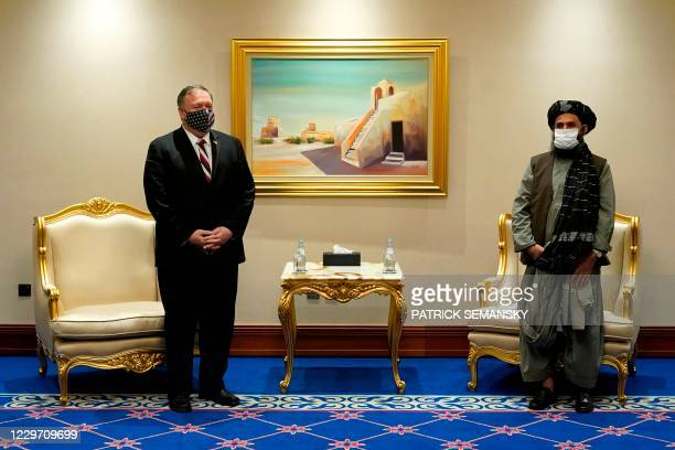 Secretary of State Mike Pompeo meets with Taliban co-founder Mullah Abdul Ghani Baradar in the Qatari capital Doha on November 21 amid signs of...