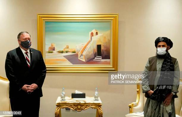 Secretary of State Mike Pompeo meets with Taliban co-founder Mullah Abdul Ghani Baradar in the Qatari capital Doha, on November 21, 2020. - US...