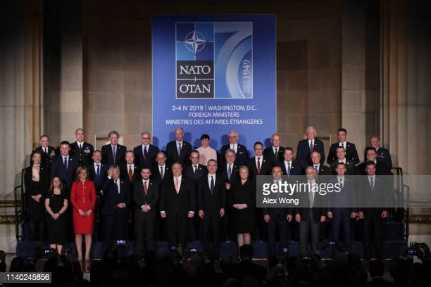 S Secretary of State Mike Pompeo NATO Secretary General Jens Stoltenberg and other foreign ministers participate in a family photo during a reception...