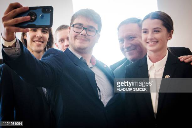 US Secretary of State Mike Pompeo poses for a selfie with participants of a discussion The Legacy of 1989 Courage to be free with Slovak youth on...