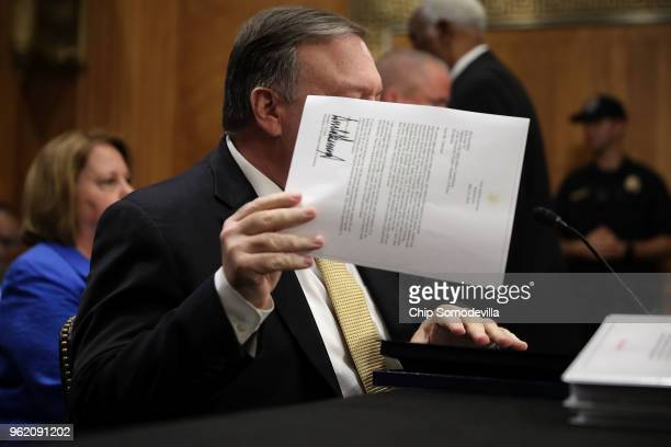 S Secretary of State Mike Pompeo pulls out a copy of President Donald Trump's letter to North Korean leader Kim Jong Un before Pompeo testifies to...