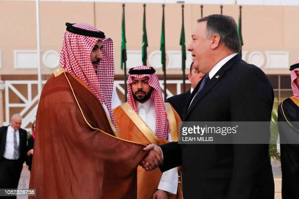 US Secretary of State Mike Pompeo shakes hand with a Saudi official before leaving Riyadh Saudi Arabia on October 17 2018 US President Donald Trump...