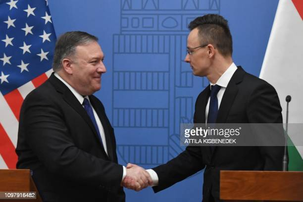 US Secretary of State Mike Pompeo shakes hand with Hungary's Minister of Foreign Affairs and Trade Peter Szijjarto after their joint press conference...