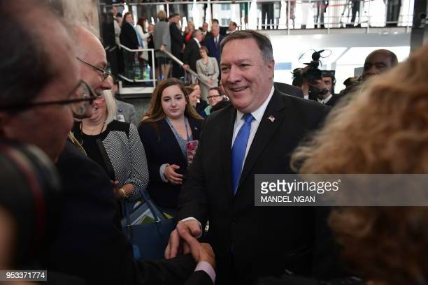 US Secretary of State Mike Pompeo shakes hands after he delivered remarks to State Department employees upon his arrival to the department on May 1...