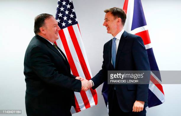 Secretary of State Mike Pompeo shakes hands with Britain's Foreign Secretary Jeremy Hunt at the European Council in Brussels on May 13, 2019. - The...
