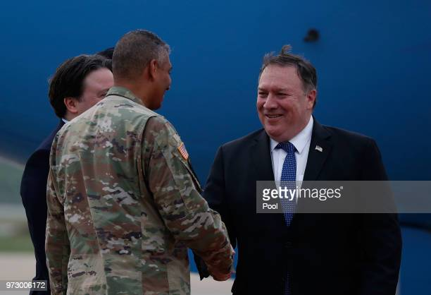 S Secretary of State Mike Pompeo shakes hands with commander of United States Forces Korea General Vincent Brooks upon his arrival at Osan Air Base...