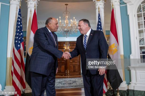 Secretary of State Mike Pompeo shakes hands with Egyptian Foreign Minister Sameh Shoukry, at the Department of State on December 9, 2019 in...