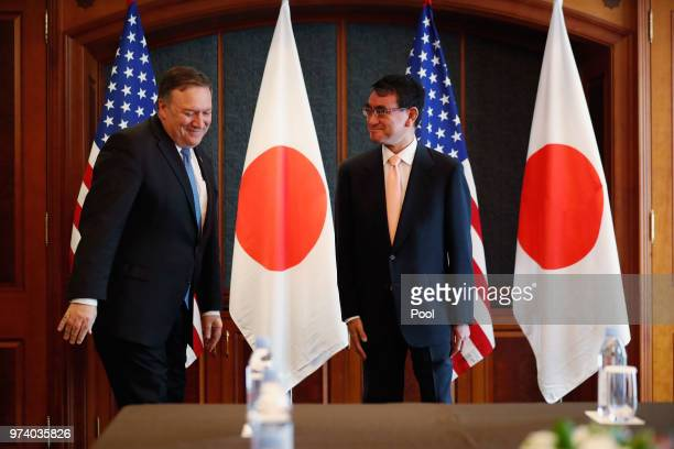 S Secretary of State Mike Pompeo shakes hands with Japanese Foreign Minister Taro Kono before their meeting at South Korea's foreign ministry on June...