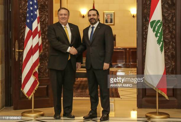 US Secretary of State Mike Pompeo shakes hands with Lebanon's Prime Minister Saad Hariri in the capital Beirut on March 22 2019 Pompeo's trip comes...