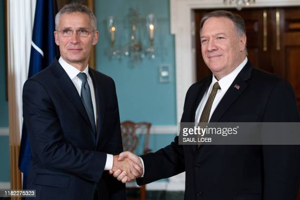 Secretary of State Mike Pompeo shakes hands with NATO Secretary General Jens Stoltenberg prior to a meeting at the State Department in Washington,...