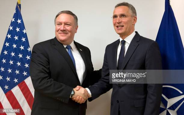 US Secretary of State Mike Pompeo shakes hands with NATO Secretary General Jens Stoltenberg prior to a meeting at NATO headquarters in Brussels on...