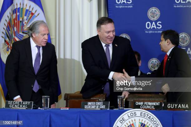 S Secretary of State Mike Pompeo shakes hands with Organization of American States Permanent Council Chair Riyad Insanally of Guyana with...